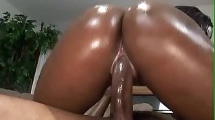 Cum inwards the black oiled pussy