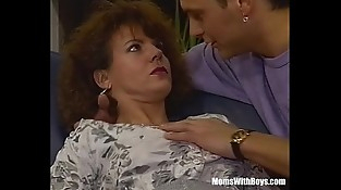 A Hairy Pussied Brunette Mummy Fucked In The Couch