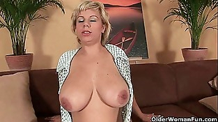 Soccer mom works her mature pussy with a faux-cock