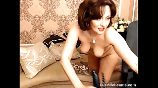 Russian mature toys her ballsack on webcam
