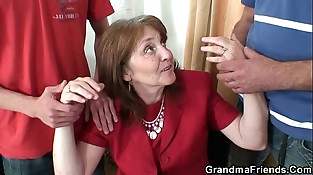 Bossy old lady takes two dicks at once